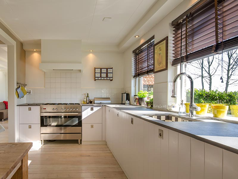 Clean Contemporary Kitchen with Venetian Blinds